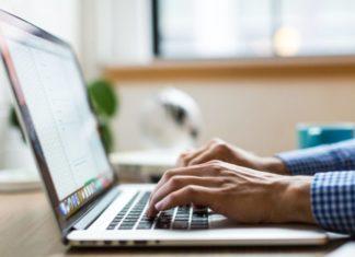 Bitstamp registration and verification on a laptop.